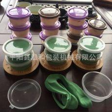 齐发娱乐官方网站_超轻粘土灌装 装杯机 自动灌装 盖盖子